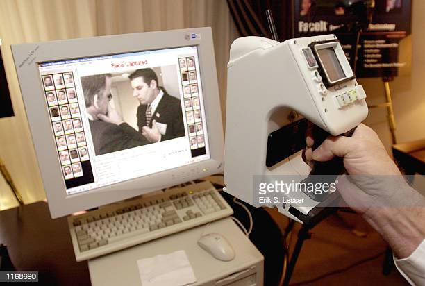 The IBIS portable identification device manufactured by Visionics Corporation is demonstrated October 17 2001 at the IATA's AVSEC 2001 Symposium in...