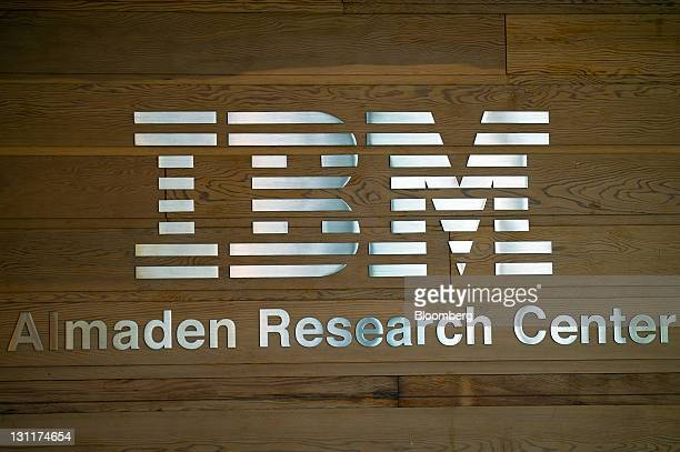 The IBM logo and signage is displayed on a wall at the IBM Research Almaden facility in San Jose California US on Friday Oct 28 2011 In a windowless...