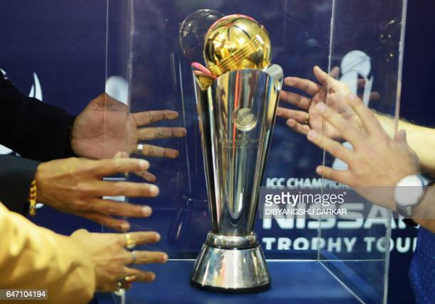 The ICC Champions Trophy 2017 is unveiled by former Indian cricketer Deep Dasgupta during a promotional campaign in Kolkata on March 2 2017 / AFP...