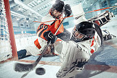 The ice hockey sport female players in action, motion, movement. Sport comptetition concpet, girls on training or game at arena. Game concept. 3D model of the stadium was created by me (the author).