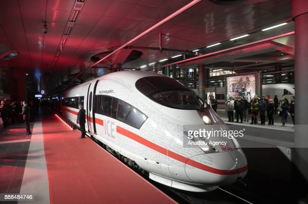 The ICE InterCityExpress Train arrives at the Berlin Central Train Station or Hauptbahnhof during the first journey of the high speed track that...