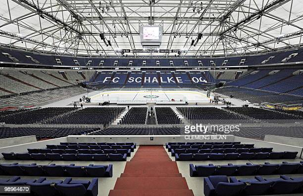 The ice rink for the opening match of the 2010 Ice Hockey World Championship is prepared at the Arena in the western German city of Gelsenkirchen on...