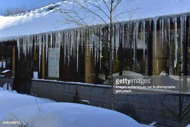 The ice stalactites along glass wall of restaurant