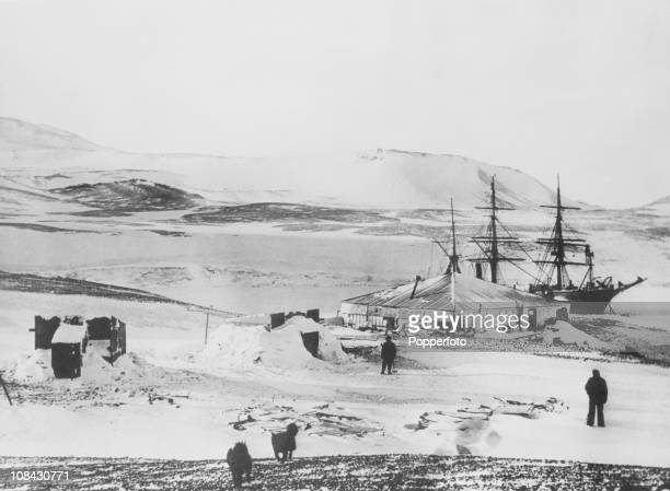 The icebound British National Antarctic Expedition ship Discovery and the winter quarters of Robert Falcon Scott's Antarctic expedition at Winter...