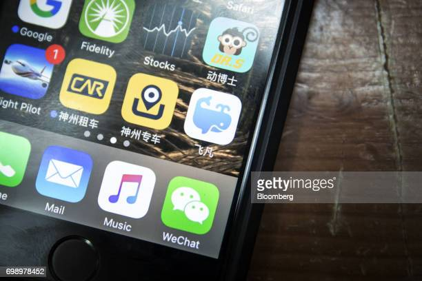 The icon for the Ffan application known as feifan in Chinese developed by Dalian Wanda Group Co middle row right is seen on a smartphone in Shanghai...