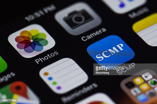 The icon for the South China Morning Post app right is arranged for a photograph on the home screen of an Apple Inc iPhone 6s in Hong Kong China on...