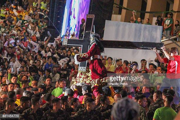 GRANDSTAND MANILA NCR PHILIPPINES The Icon is carried in his peana by the Hijos del Nazareno from his pedestal at the Grandstand towards the andas...