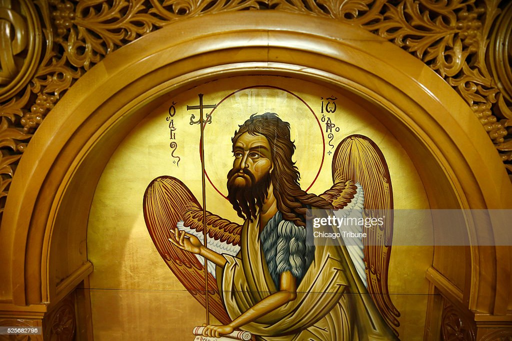 The icon of St. John the Baptist at Assumption Greek Orthodox Church in Homer Glen, Ill., on Thursday, April 28, 2016. Rev. Sotirios Dimitriou, recently had been hospitalized. When he went to kiss the icon he saw and smelled what they described as a fragrant oil seeping from John the Baptist's hands, hair, halo and beard -- everywhere but his eyes. Since that day, the priest's health gradually has improved. 'I can't explain to you the reason why it started,' Dimitriou said. 'It's a blessing for our community.'