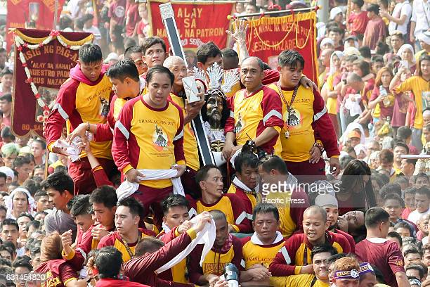 AVE MANILA NCR PHILIPPINES The Icon of the Black Nazarene is surrounded by Hijos del Nazareno who direct the devotees who pull the anadas of the Icon...