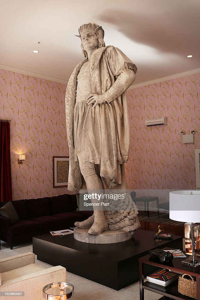 The iconic 13-foot statue of Christopher Columbus is viewed from the 810-square-foot 'living room' art installation by Japanese artist Tatzu Nishi on September 19, 2012 in New York City. Viewed as a piece of conceptual art, 'Living Room', which sits 70-feet above ground level and is only accessible via a scaffold-encased staircase, has been temporarily built around the Columbus Monument in Columbus Circle. Beginning Thursday, up to 25 people at a time can enter the living room to view up close the 1892 marble figure of the Italian explorer.