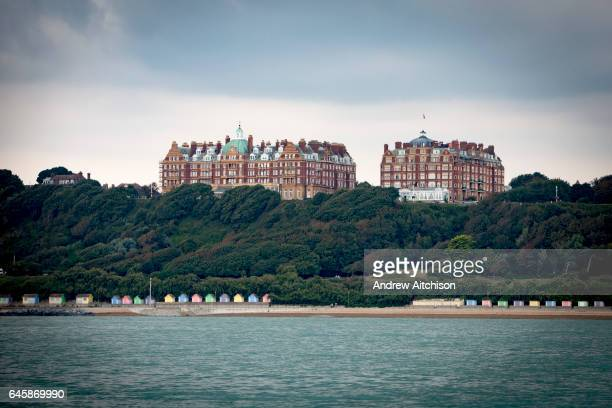 The iconic buildings of Metropole and The Grand buildings stand on The Leas at the top of Radnor Cliff tree lined hill below is the Lower Leas...