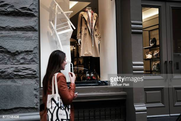 The iconic Burberry trench coat is displayed in a window of a Burberry store on November 9 2017 in New York City Shares for the heritage English...