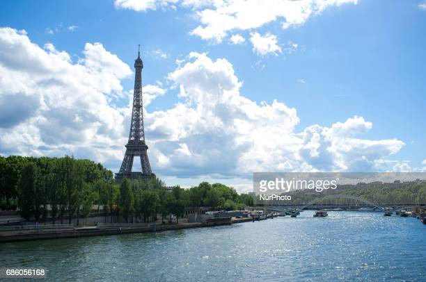 The iconic Eiffel Tower is seen with the tourists in Paris on May 20 2017 The Eiffel Tower is a wrought iron lattice tower on the Champ de Mars in...