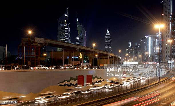 The iconic Emirates Towers dominate the skyline beyond the partially constructed new metro system on December 3 2007 in Dubai United Arab Emirates...