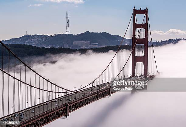 The iconic Golden Gate Bridge is enveloped in a bank of heavy fog on February 13 in San Francisco California San Francisco continues to be a major...