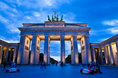 The iconic landmark of the Brandenburger Tor floodlit at twilight in Berlin