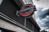 The iconic London Underground Logo denoting the entrance to a 'Tube' station London UK against a stormy sky