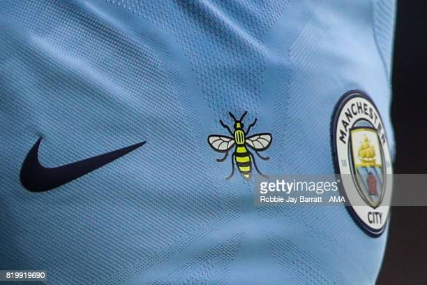 The iconic Manchester bee on a Machester City shirt in respect of the attack in Manchester during the International Champions Cup 2017 match between...