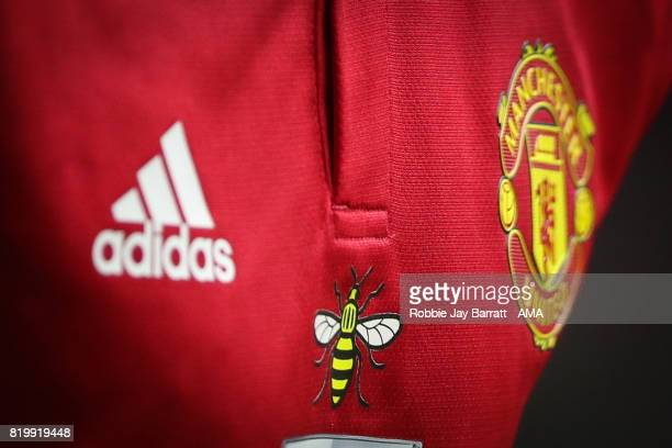 The iconic Manchester bee on a Machester United shirt in respect of the attack in Manchester during the International Champions Cup 2017 match...