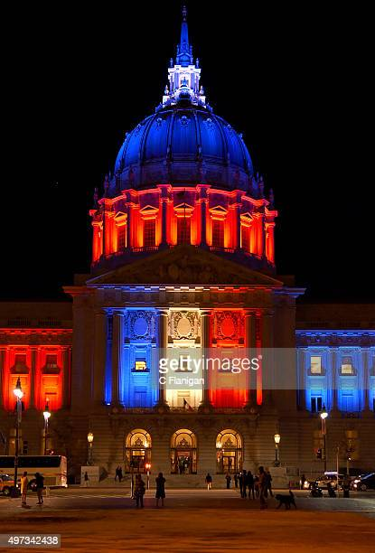 The iconic pillars of San Francisco City Hall are lit in red white and blue resembling the colours of the French flag in San Francisco on November 14...
