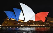 The iconic sails of the Sydney Opera House are lit in red white and blue resembling the colours of the French flag in Sydney on November 14 as...