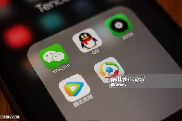 The icons for Tencent Holdings Ltd applications WeChat clockwise from top left QQ JOOX Tencent News and Tencent Video are arranged for a photograph...