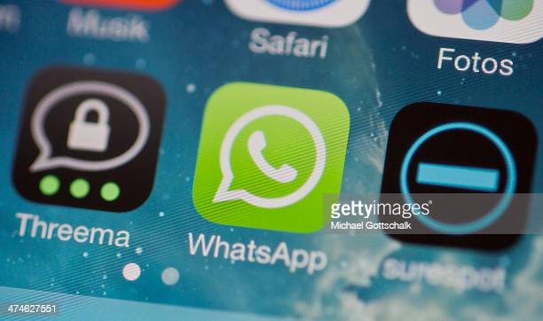 The icons of the messenger apps Whatsapp Surespot and Threema on a display of a cellphone on February 24 2014 in Berlin Germany Whatsapp was acquired...