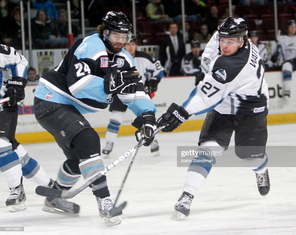 The Idaho Steelheads' Ian Watters (27) takes a shot in the second period, defended by the Alaska Aces' Sean Curry (24) at CenturyLink Arena in Boise, Idaho, on Friday, January 18, 2013.