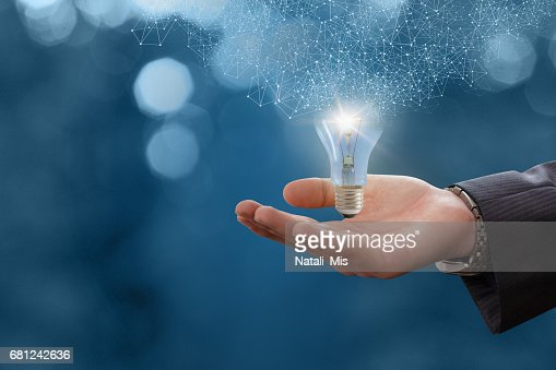 The idea in the hand businessman. : Stock Photo