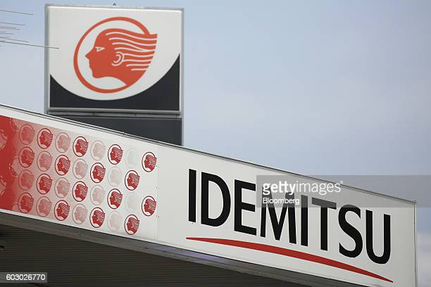 The Idemitsu Kosan Co logo is displayed atop the company's gasoline station in Tokyo Japan on Friday Aug 12 2016 At an Idemitsu shareholder meeting...