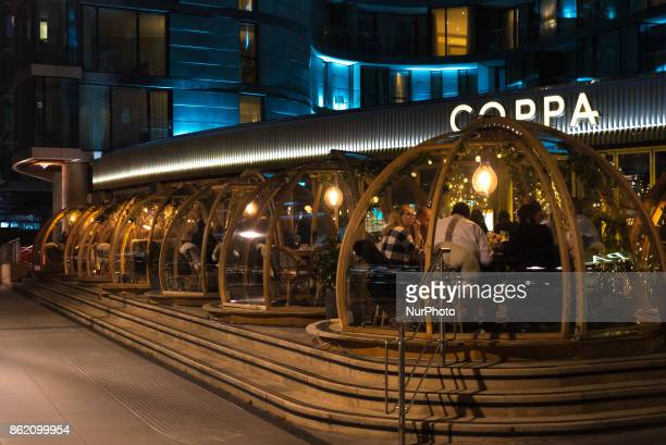 The igloos are seen on the Thamesside terrace of the Coppa Club restaurant on the north bank of river Thames in London on October 16 2017