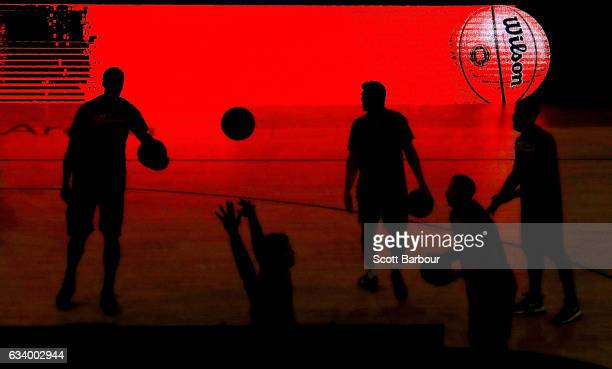 The Illawarra Hawks are silhouetted by an electronic advertising board as they warm up during the round 18 NBL match between Melbourne United and the...