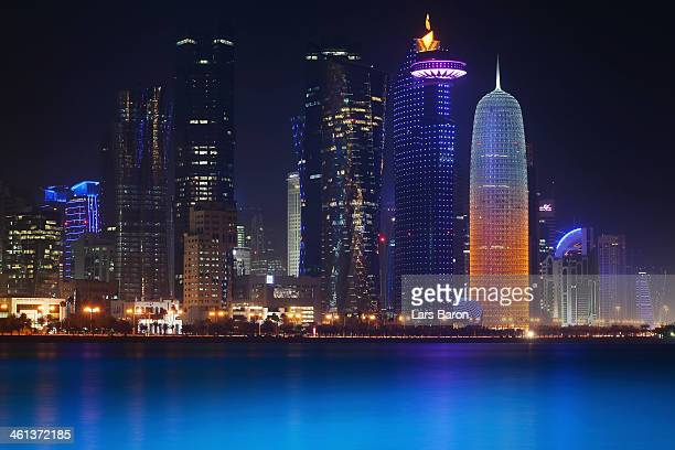 The illuminate skyline of Doha is seen on January 7 2014 in Doha Qatar