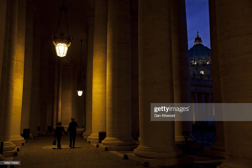 The illuminated Basilica is seen through the colonnade in Saint Peter's Square on March 9, 2013 in Vatican City, Vatican. Cardinals are set to enter the conclave to elect a successor to Pope Benedict XVI after he became the first pope in 600 years to resign from the role. The conclave is scheduled to start on March 12 inside the Sistine Chapel and will be attended by 115 cardinals as they vote to select the 266th Pope of the Catholic Church.