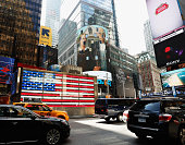The image of 'American Gothic 1930' by Grant Wood is seen on the side of the NASDAQ building during the 'Art Everywhere US A Very Very Big Art Show'...