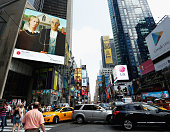 The image of 'American Gothic' by Grant Wood is seen on an electronic billboard during the 'Art Everywhere US A Very Very Big Art Show' in Times...
