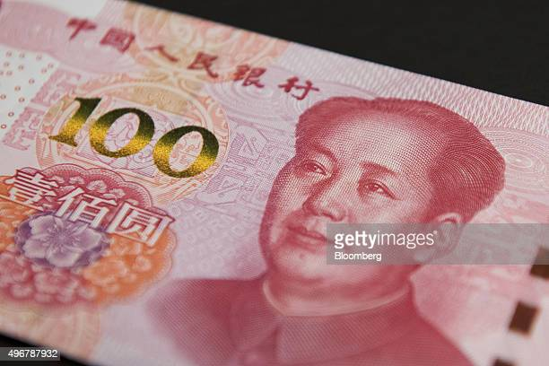 The image of former Chinese leader Mao Zedong is displayed on a onehundred yuan banknote in an arranged photograph at the Bank of China Hong Kong Ltd...