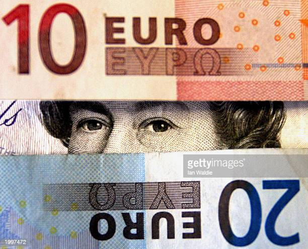 The image of Queen Elizabeth II on a 20 sterling note is seen between Euro banknotes May 14 in London The Chancellor of the Exchequer Gordon Brown is...