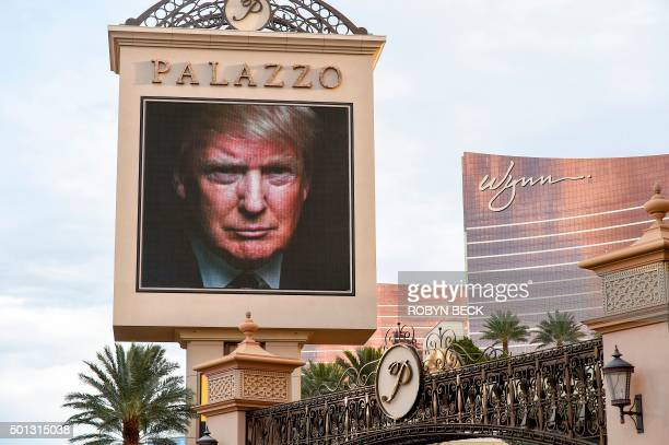 The image of Republican presidential hopeful Donald Trump is seen on an electronic display announcing the upcoming Republican presidential debate...