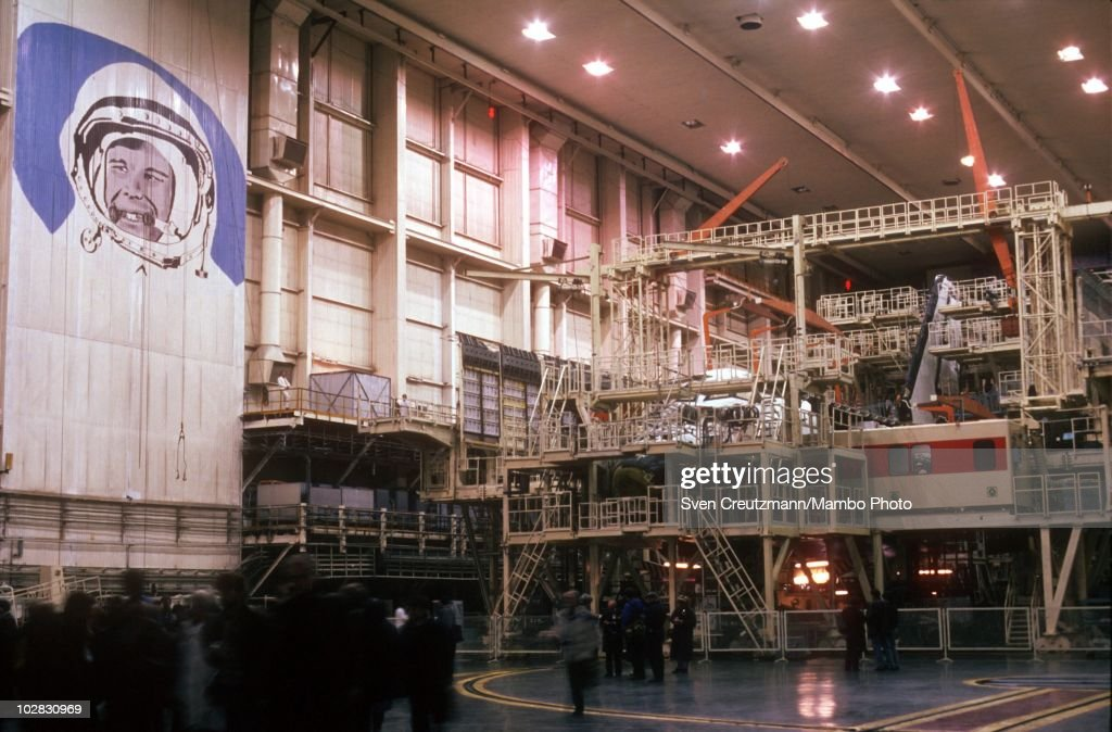 The image of Russian cosmonaut Yuri Gagarin overlooks the construction site of a Buran spacecraft in a hangar on March 19 in Moscow Russia The Buran...