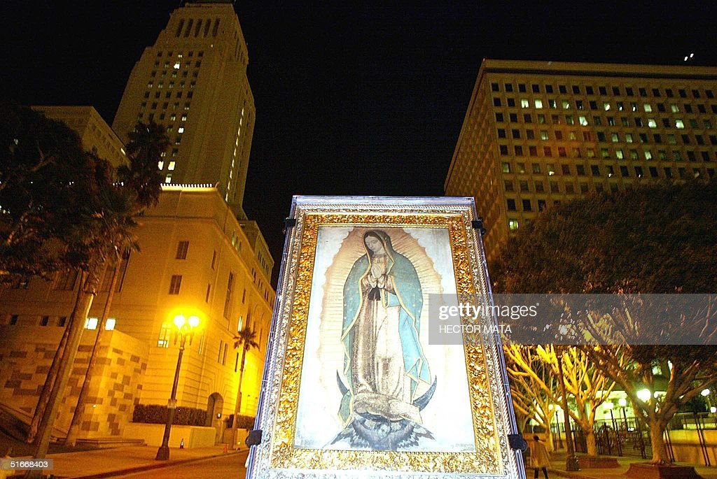 The image of the Virgen de Guadalupe is carried through downtown Los Angeles during an early procession marking Guadalupe Day 12 December 2002 The...