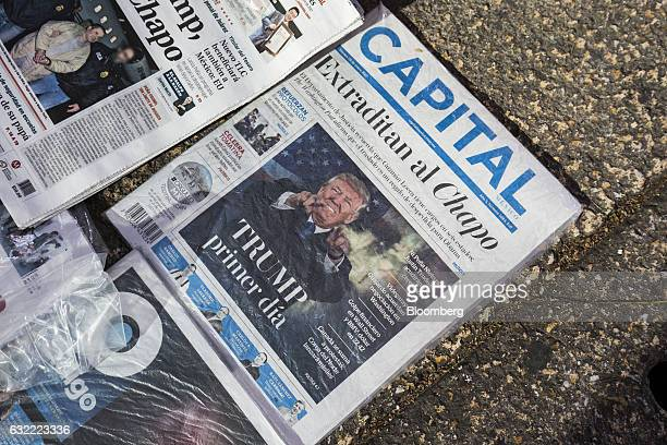 The image of US President Donald Trump is displayed on the front page of a stack of newspapers on sale at a newsstand in Mexico City Mexico on Friday...