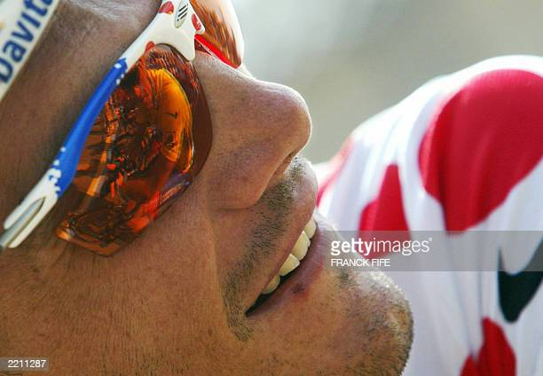 the image of yellow jersey Lance Armstrong reflects in Frenchman Richard Virenque's glasses before the 18th stage of the 90th Tour de France cycling...