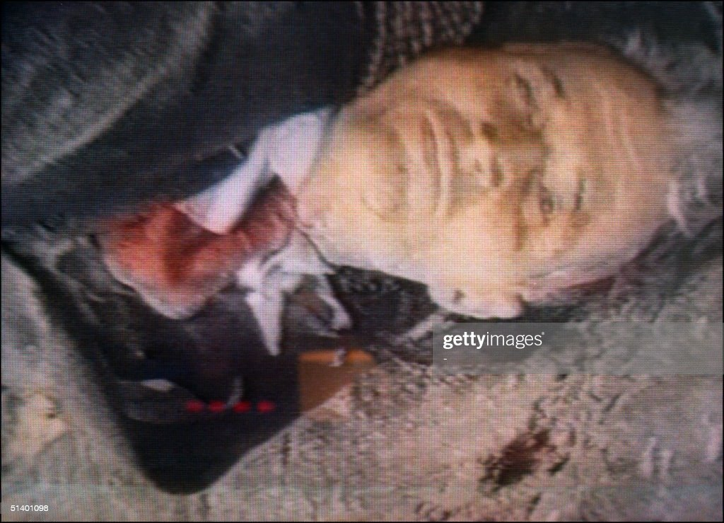 The image released 26 December 1989 in Bucharest by Romanian National Television of the body of the ousted Romania communist party's general secretary and President Nicolae Ceaucescu, reportedly the image made of Romanian dictator immediately after his execution 25 December 1989 in Bucharest. Ceaucescu and his wife Elena were deposed by the army and executed by firing squad 25 December 1989 after being found guilty by an army tribunal of 'crimes against the people', including genocide leading to an alleged 60,000 deaths. The anti-Communist uprising ending Ceausescu's 24 years of dictatorial rule started 16 December as a small protest in Timisoara and later 21 December during a huge anti-communist demonstration at the Republic Square in front of Romanian Communist Party Central Committee headquarters.