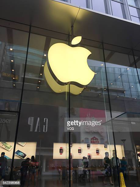 The image shows the logo of Apple outside an Apple store at Nanjing East Road on June 22 2016 in Shanghai China A local company called Shenzhen Baili...