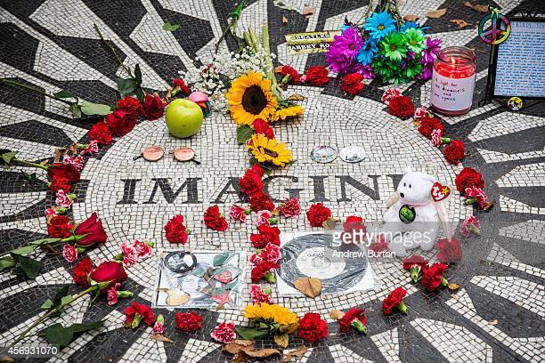 The 'Imagine' tile mosaic in the Strawberry Fields section of Central Park created to honor John Lennon is seen on October 9 2014 in New York City...
