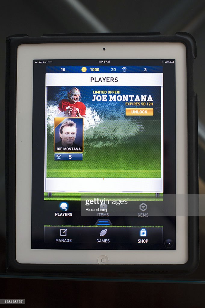 The iMFL game is displayed for a photograph on an Apple Inc. iPad after an interview with Joseph 'Joe' Montana, co-founder of iMFL and retired National Football League (NFL) quarterback, in San Francisco, California, U.S. on Tuesday, April 30, 2013. iMFL, a fantasy football application that will be available for download at the Apple Inc. App Store, will be released before the start of the 2013 NFL season. Photographer: David Paul Morris/Bloomberg via Getty Images