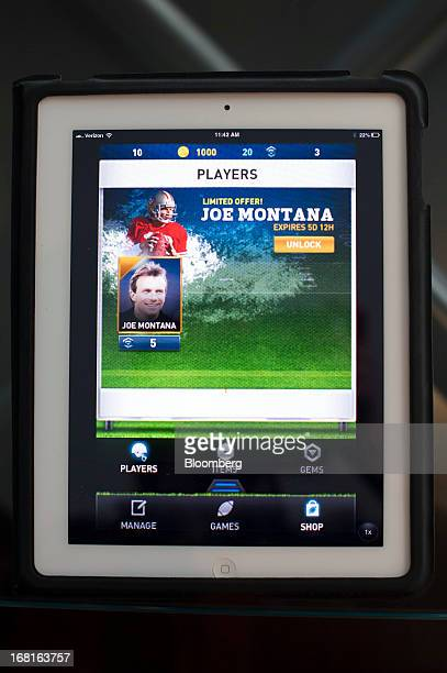 The iMFL game is displayed for a photograph on an Apple Inc iPad after an interview with Joseph 'Joe' Montana cofounder of iMFL and retired National...