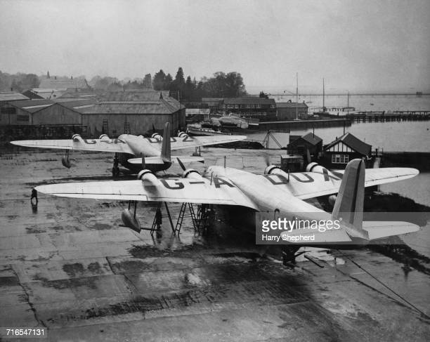 The Imperial Airways Short Empire mediumrange fourengined monoplane flying boats GADUX Cassiopeia and GADUZ Cygnus prepare for their flights to...