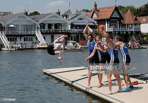 The Imperial College London 'A' crew throw their cox in the river after winning the Prince Albert Challenge Cup final on finals day of the Henley...